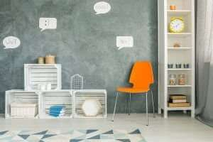 Room with orange chair crate furniture and white regale